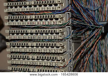 patch panel in datacenter server room a plurality of cables cross bar