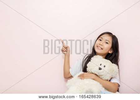 Child Little Girl Asian Thai Nationality With White Toy Teddy Bear Over Pink Wall Background Pointin