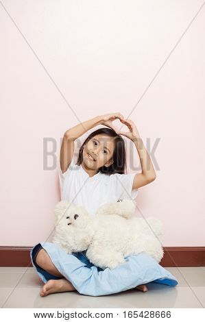 Child Little Girl Asian Thai Nationality With White Toy Teddy Bear Shows Hands Valentine Love Sign O