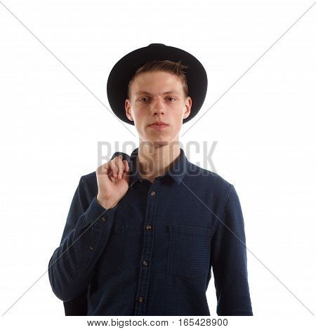 A man wearing a blue shirt and a fedora