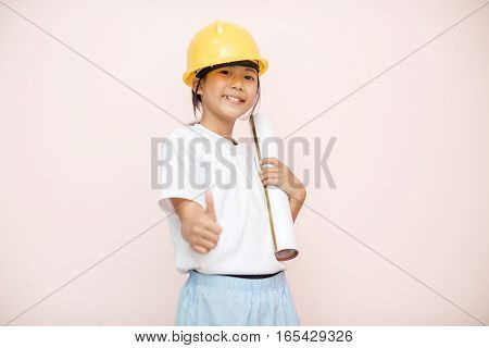 Smile Little Girl As Architect Engineer Dream To Future Shows Good Hand.