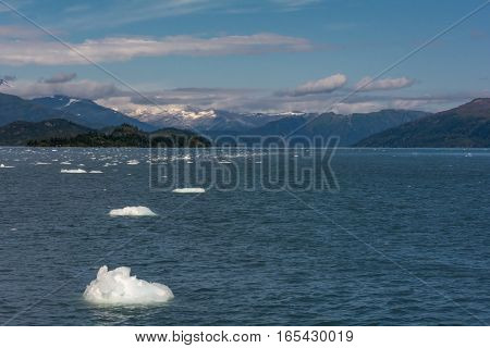 Waves lap against small ice chuncks floating on Prince William Sound.