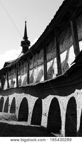 Wall of Kirillo-Belozersky monastery by day near City Kirillov Vologda region Russia. Black and white.