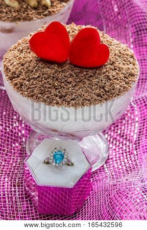 Dessert tiramisu (cheese dessert) in bowls with ring for proposal of marriage