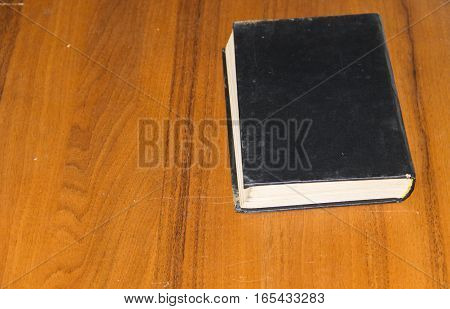 The old book on the wooden table