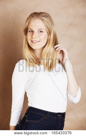 young cool blonde teenage girl smiling, lifestyle people concept close up