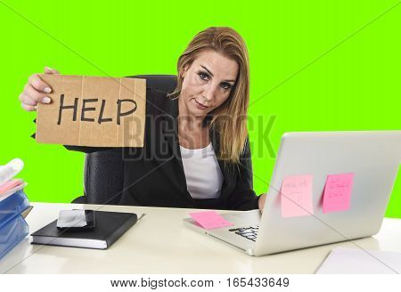 frustrated business woman in her 40s holding help sign desperate suffering stress overworked working at office laptop computer in sad worried face expression isolated green chroma key screen