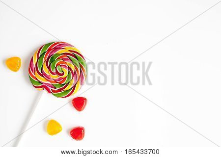 sweets and sugar candies on white background top view.