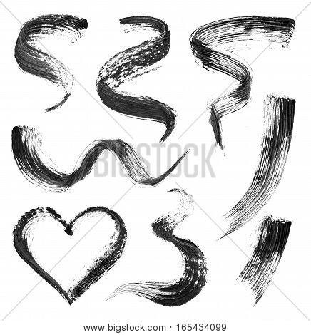Set of mascara black isolated strokes on white background