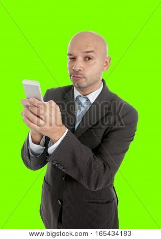 happy young friendly businessman using compulsively cell phone in social network mobile and internet addiction concept isolated on green chroma key screen background