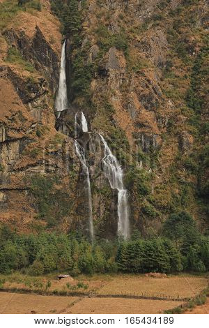 Waterfall in Tal Annapurna Conservation Area Nepal.