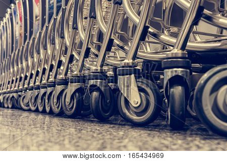 Floor view of airport trolleys. Parked and waiting for travelers.