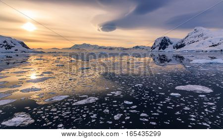 Icebergs And Sunset Reflecting In Water At Lemaire Strait, Antarctica
