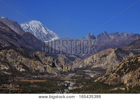 Scenery in the Annapurna Conservation Area. Runway of Hongde airport. Limestone cliffs and Tilicho Peak.