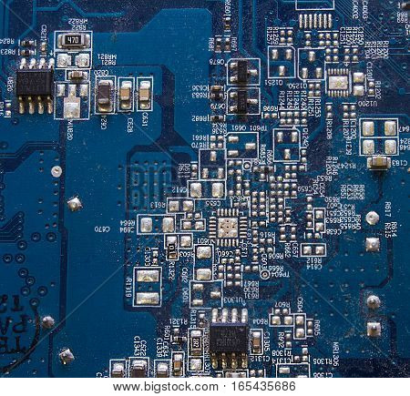 Electronic circuit board with chip, close up.