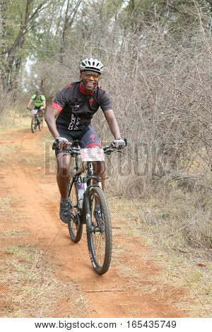 Middle Aged Black African Man Enjoying Outdoors Ride At Mountain Bike Race