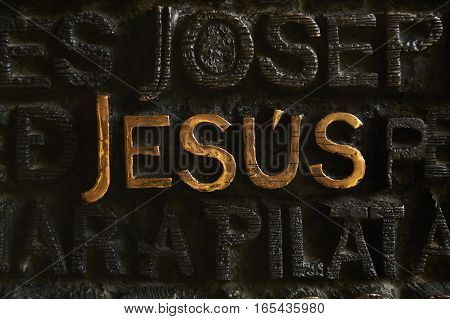 Barcelona, Spain - November 18, 2016: Jesus name written on the main door of the Passion facade of The Temple of the Sagrada Familia. Work by Josep Maria Subirachs.