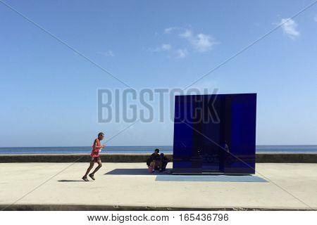 A man running along the Malecon in Havana, Cuba.