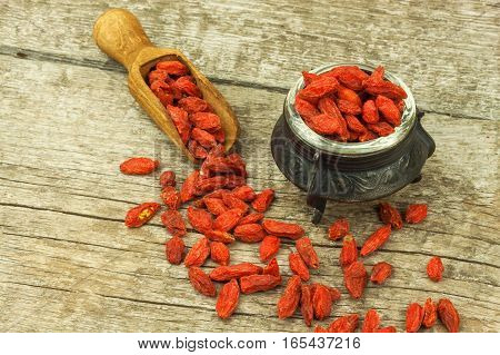 Goji Berries On The Wooden Table. Traditional Chinese Superfood. Healthy Diet Rich In Minerals And V