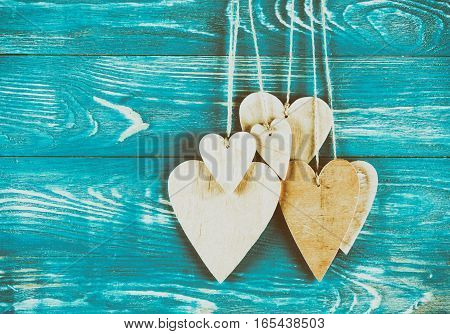 Wood hearts on old wood background. Greeting card. Valentine's day background.