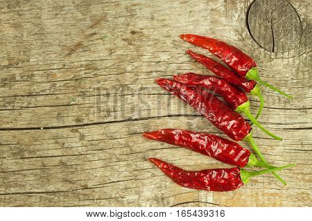 Dried Chili Peppers On Old Wooden Background. Sale Of Spices. Preparing Spicy Food. Place For Your T