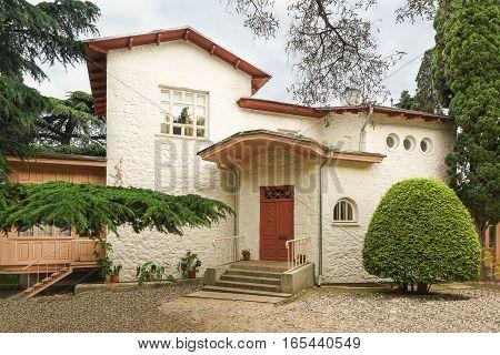 YALTA CRIMEA RUSSIA - JUNE 08.2016: Fancy architecture white dacha Anton Chekhov in Yalta
