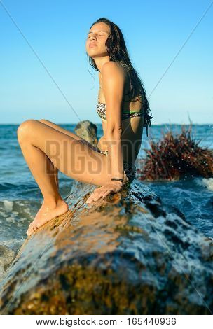 Girl Sitting On A Plank In The Water