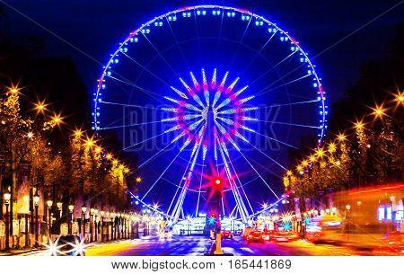 ParisFrance-December 24 2016 : The Roue de Paris is a 60-metre tall transportable Ferris wheel installed on the Place de la Concorde in Paris France.