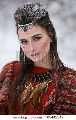 Close-up Portrait Of Native Indian Woman With Traditional Makeup And Hairstyle In Snowy Winter. Beau
