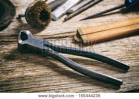 Old Plier On Wooden Background