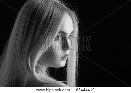beautiful girl portrait with long blond hair, monochrome
