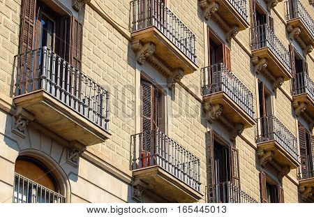Rows of windows, balconies and wrought iron balusters in Barcelona, Catalonia, Spain