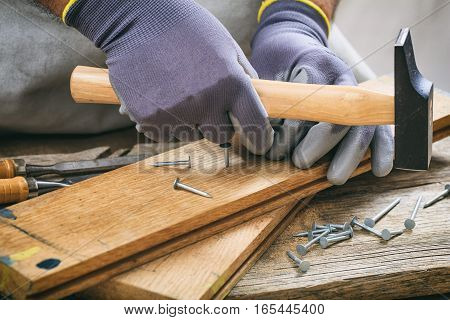 Man Working With A Hammer