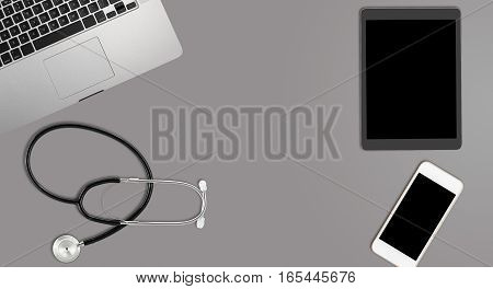 Clean and tidy grey desk with equipment ready for medical doctor using latest technology instead of paper records