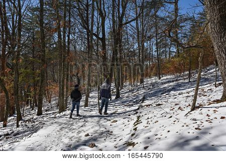 two hikers hiking on snow trail at Sawnee Mountain Preserve at North Georgia