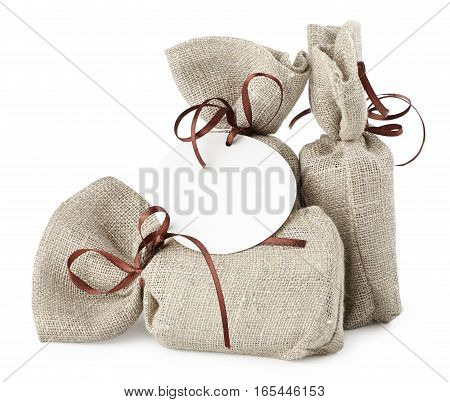 cloth bag with a gift a pleasant surprise isolated on white