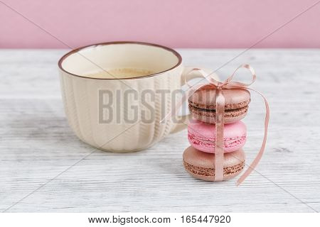 Sweet pastel french macaroons. Coffee chocolate vanilla and raspberry macaroons vintage tone