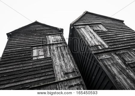 Old wooden black fishermens huts on a seafront at Hastings, East Sussex, England, UK