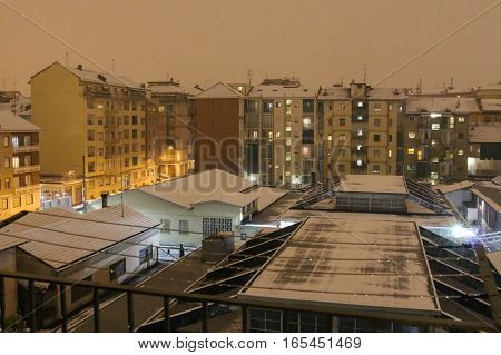 Italy Turin - February 5 2015: view of typical sleeping district with residential buildings at night in winter time. Turin. Italy. on February 05 2015 in Turin Italy.
