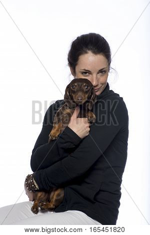 Young caucasian woman with her cute dog giving puppy eyes
