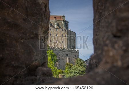 Italy Piedmont - May 9 2015: view of Saint Michael's Abbey in Val di Susa from San Sepolcro ruins window on May 9 2015 in Piedmont Italy.
