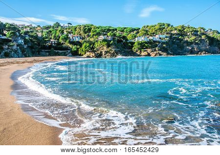 Spain. Catalonia. Costa Brava. Beach Sa Riera. Beautiful views of the Mediterranean coast. Tourist places. The picturesque promenade along the sea.