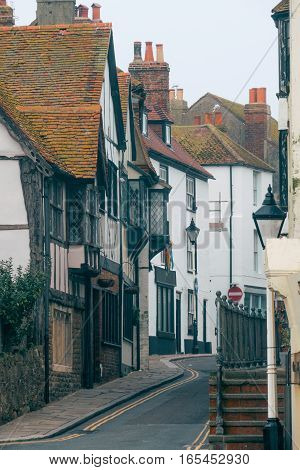 Old street with colorful houses in the town of Hastings, East Sussex, England, UK