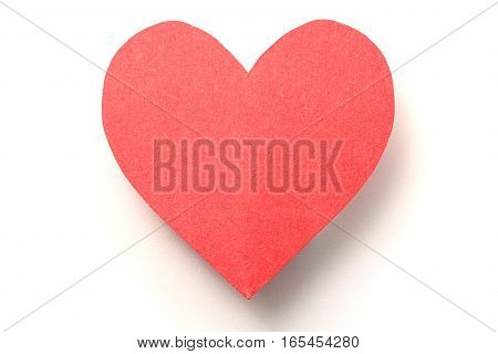 Red paper heart on white background with shadow