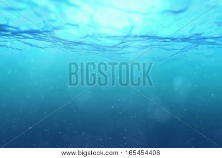 high quality deep blue ocean waves from underwater background with micro particles flowing light rays shining through