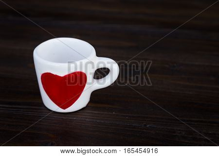 Coffee Cup With Red Heart On Table