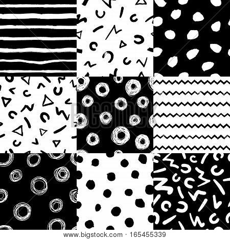 Set of 9 decorative seamless patterns with handdrawn shapes. Hand painted grungy ink doodles in black and white colors. Trendy endless texture for digital paper, fabric, backdrops, wrapping