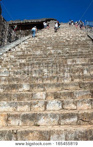 Tourists Climbing The Ek Balam Acropolis
