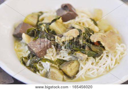Thai noodle or northern Thai noodle with pork blood and eggplant dish