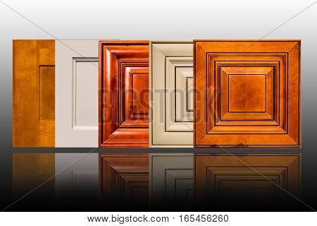 Modern home interior decorative kitchen cabinet doors. Wooden contemporary and traditional door. Maple, cherry, oak birch. Background white with surface glossy.